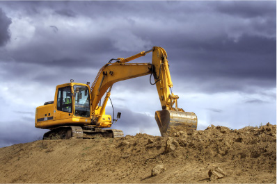 backhoe digging contaminated soil