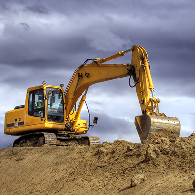 themrally treated Soil Disposal and soil remediation in new jersey with a yellow excavator digging up the soil